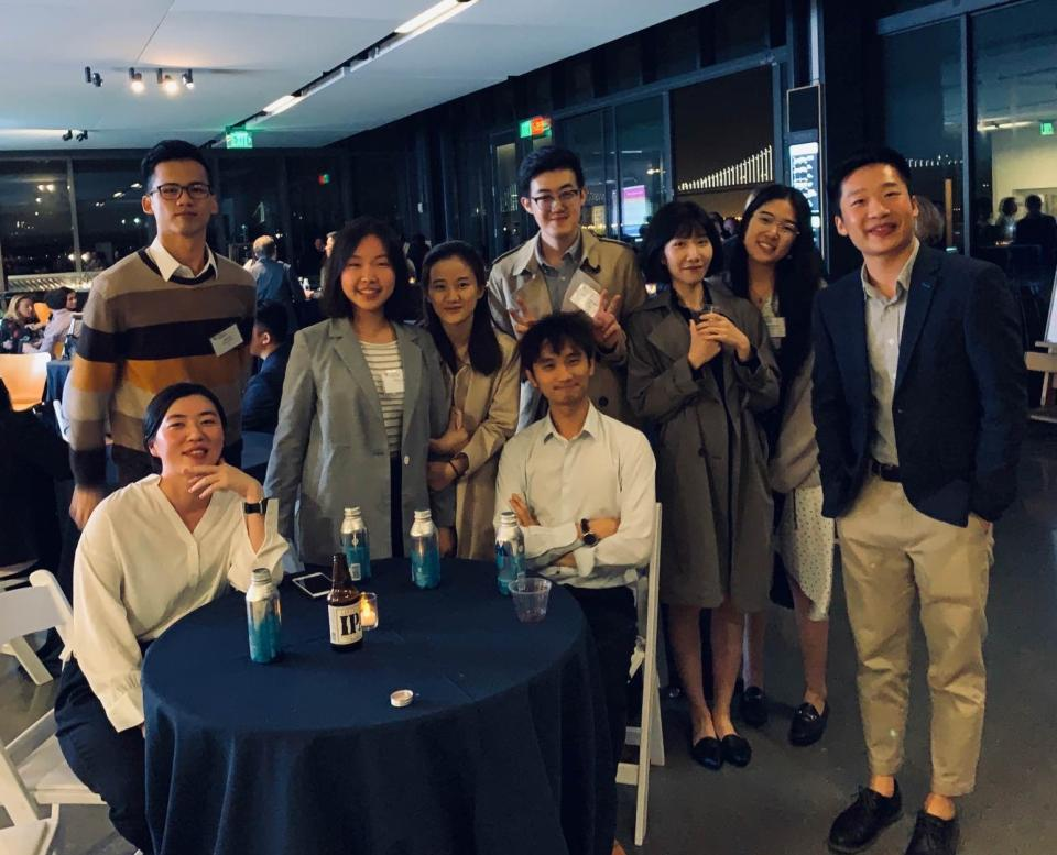 Maxine Li and Michael Chen join other MSBA students at a mixer