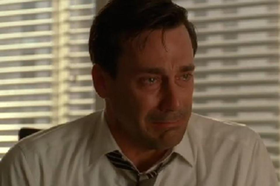 Jon Hamm crying in an office
