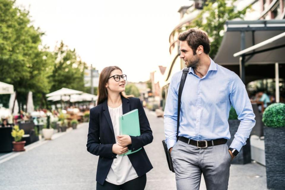 Two people on a walking meeting