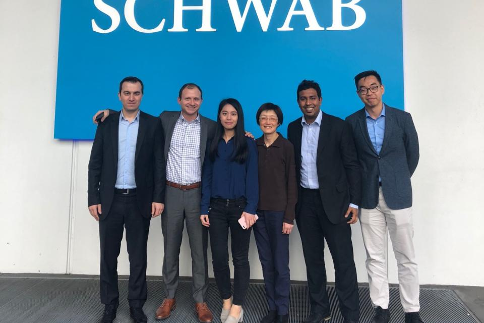 MBA students pose with Schwab executives