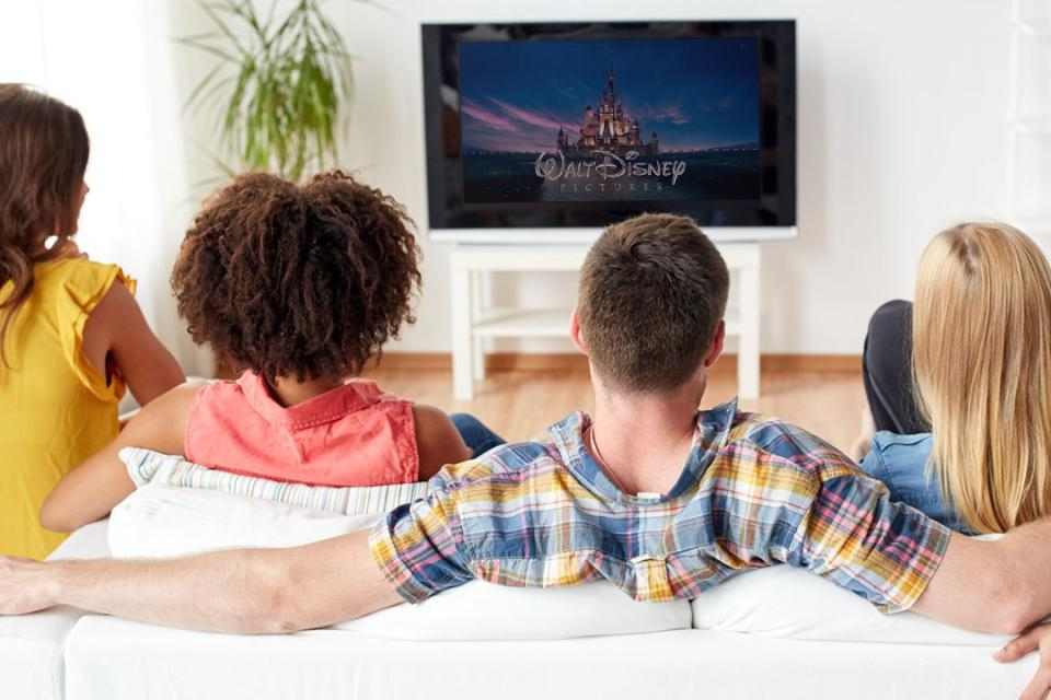 Group sitting in front of TV watching Disney